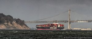 NYL Line Container Ship by Bay Bridge in San Francisco, California