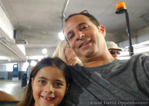 Father and Daughter Ride Golf Cart in Atlanta Airport